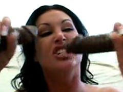 Slut slurps on 2 big black dicks at the same time