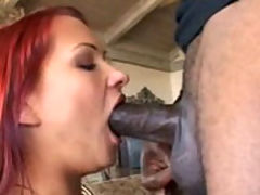 Smoking redhead deep throats his long shaft