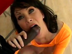 Her tongue playfully licks at the head of his cock