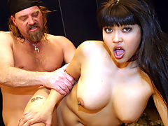 Mika Tan takes a hard white cock up her tight asshole