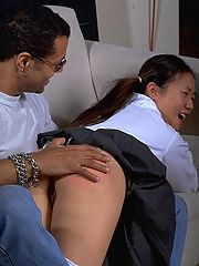 Asian schoolgirl's ass turns red as she's paddled