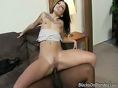 Young playful blonde riding blackie