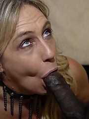 This blonde mature slut loves two hard black cocks