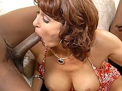 Kinky housewife sucking two hard black cocks